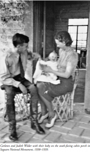 Carleton and Judith Wilder with their baby on the south-facing cabin porch in Saguaro National Monument, 1938–1939