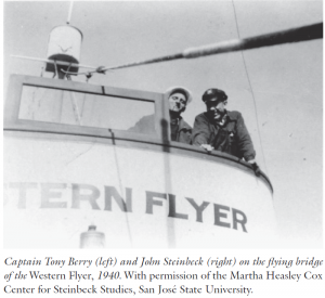 John Steinbeck on the flying bridge of the Western Flyer